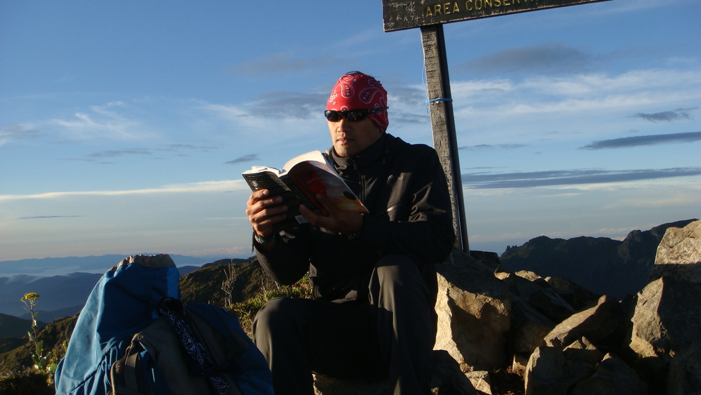 Reading a book on the summit of Mt. Chirripo in Costa Rica.
