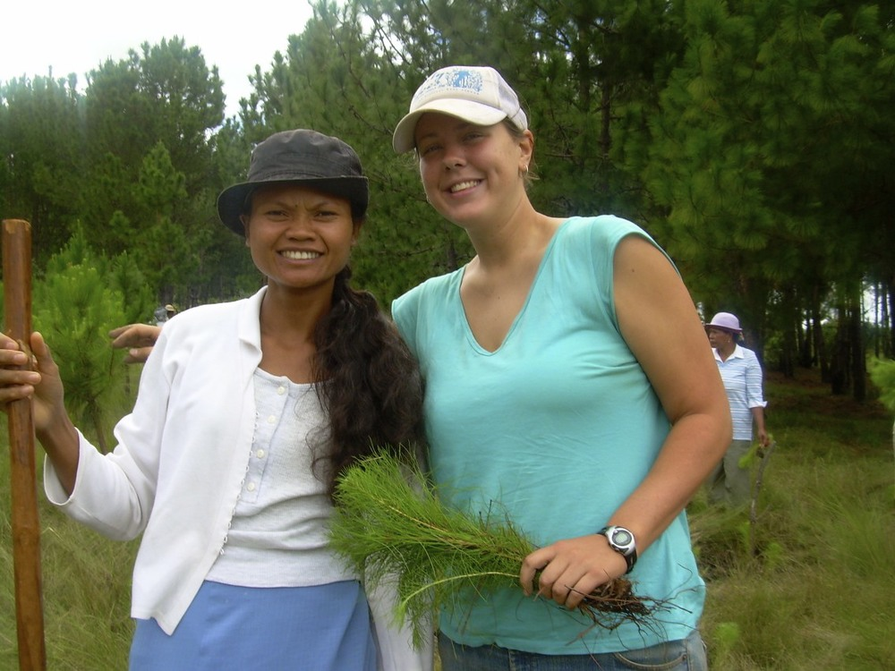 Sara with her friend, Marthe, planting trees on International Women's Day.