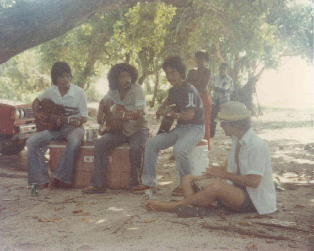 Steve Latin-Kasper playing drums with his band in the Marshall Island