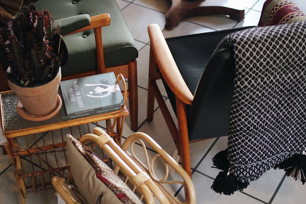 Pictured:  Teak and Faux Leather Chair #60 ,  Bamboo Glass Table with Magazine Holder #49  and  Bamboo Rattan Foldable Magazine Stand #32 .