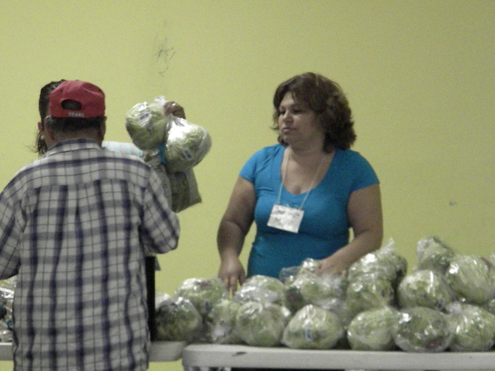 Volunteers at CDEF handing out food those who came for aid.
