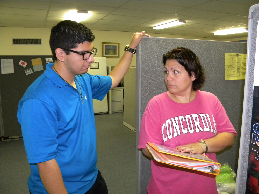 Intern, Chris, working with Perla on organizing service events.