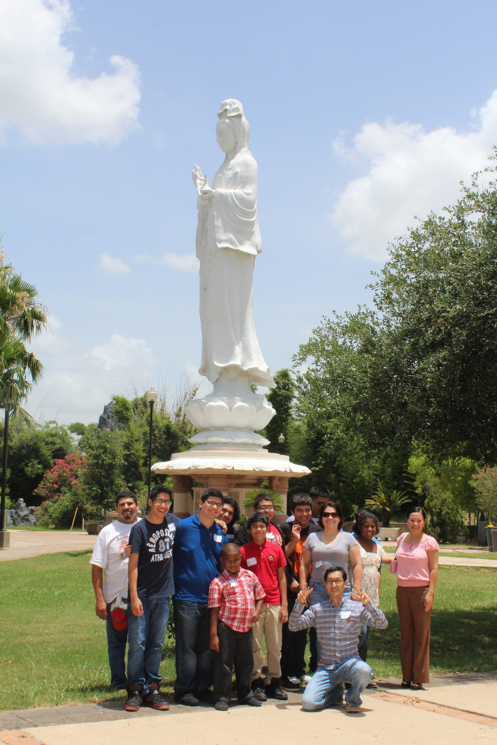 In front of the 72 foot statue at the Buddhist Temple.