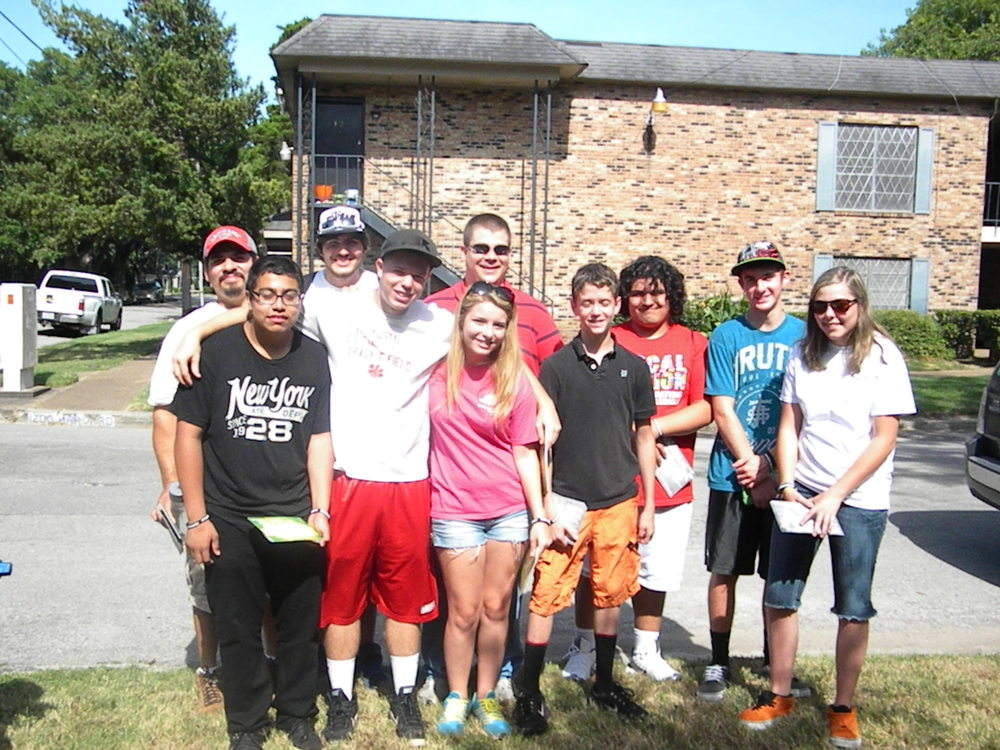 GA Mission Group and LINC's Summer Youth Group Handing Out Fliers.