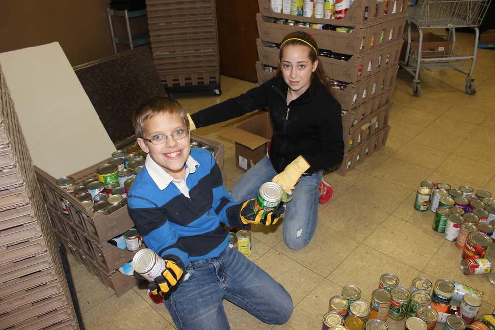 Students sorting canned goods for the food pantry at CDG.