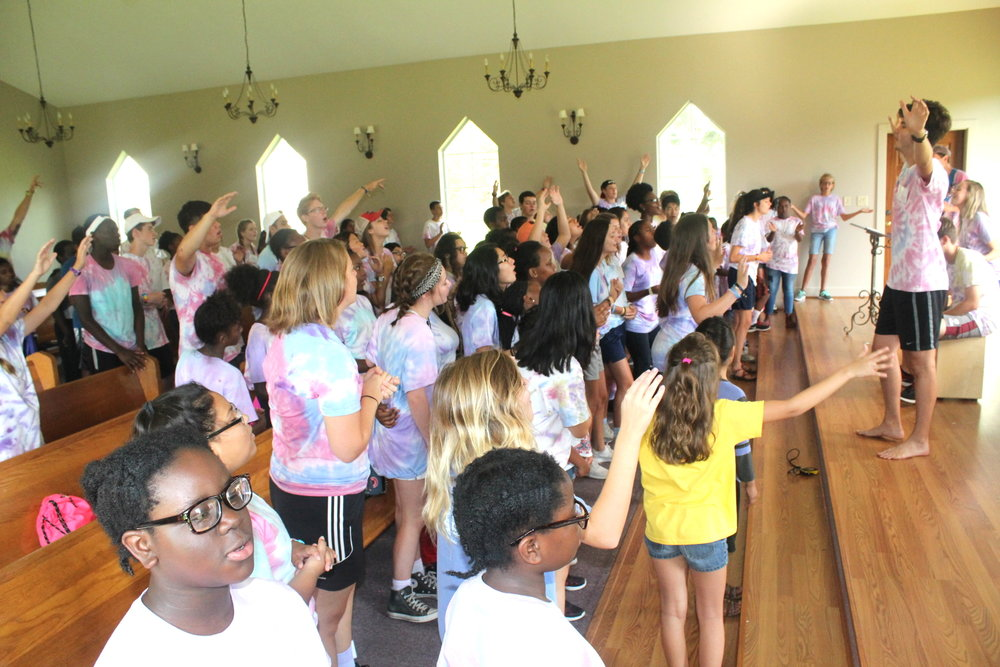 Kids at camp engaged in fun, passionate worship of Jesus.