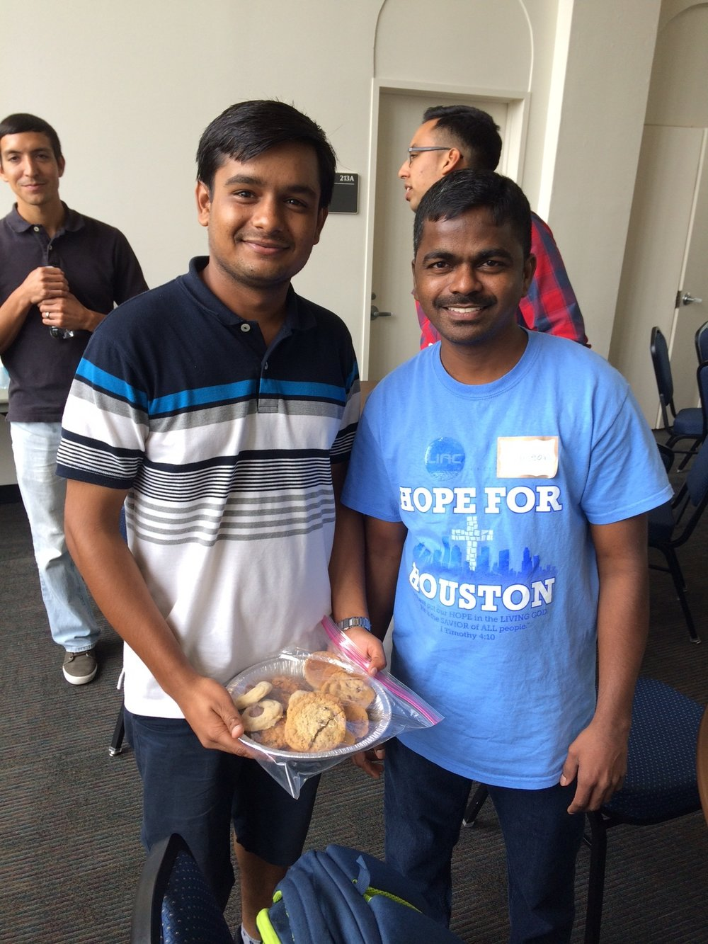LINC evangelist Simeon Mesa shares some cookies with a Hindu student. Pray that he will be open to the sweet love of Jesus.