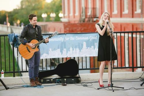 Kelsey Lewis and Jordan Critz performing on the patio