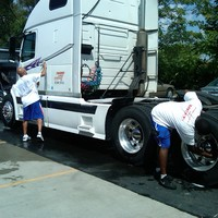 carwash fundraiser coaches washing cars for bond hill flyers track.jpg