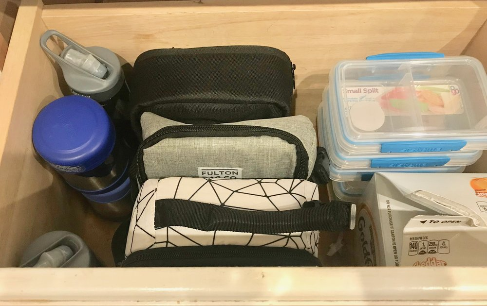 01 - 1. Find a space in your kitchen to store all of your lunch making items. Lunch boxes, water bottles, sandwich containers, etc.