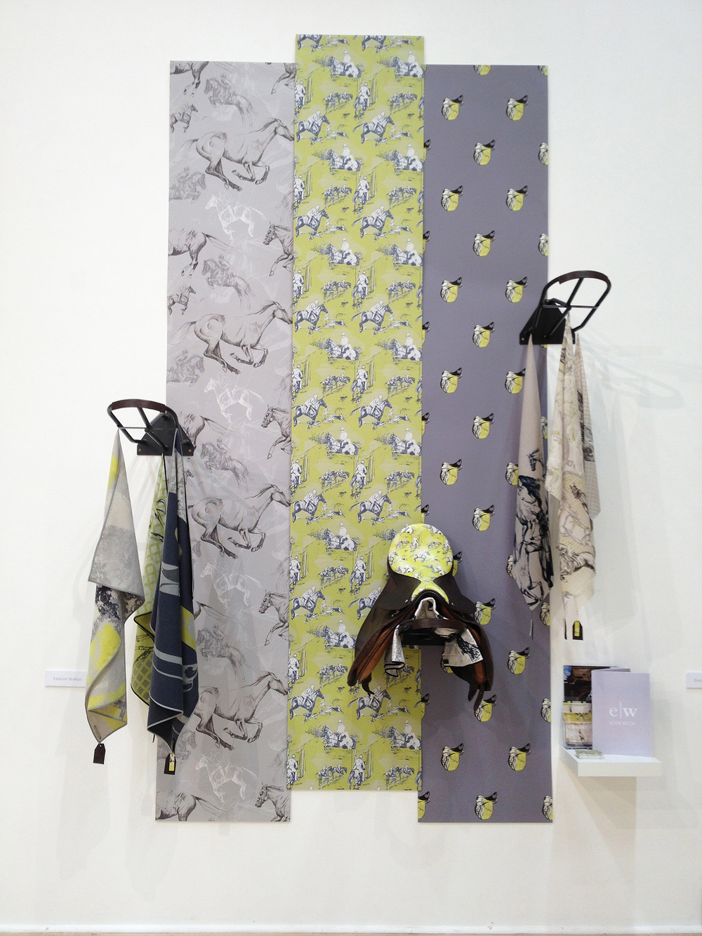 Ellie Walton- Printed Textile Designer www.eleanorwalton.moonfruit.com Ellie's 'Saddle up' range is right on trend for Autumn/WInter 2014. I love the use of accent colour and her display using saddle racks.