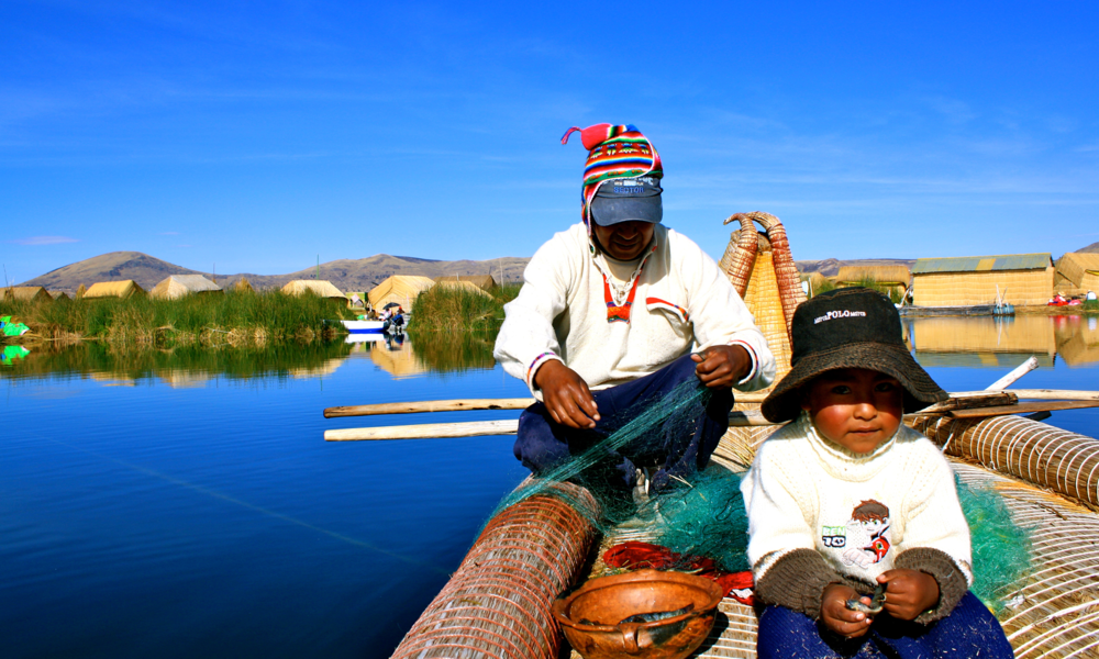 Fishing on Lake Titicaca in Peru with our Uros hosts, Reuben and Francisco (aka the cutest little fisherman).