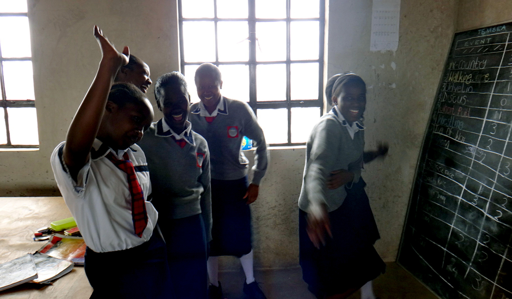 Gladys, Jessica, Jennifer, Faith and Ester showing us their classroom at the Tembea Girls High School in Kajiado, Kenya.