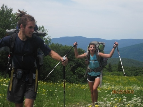 Hikers on the Appalachian Trail with flowers.
