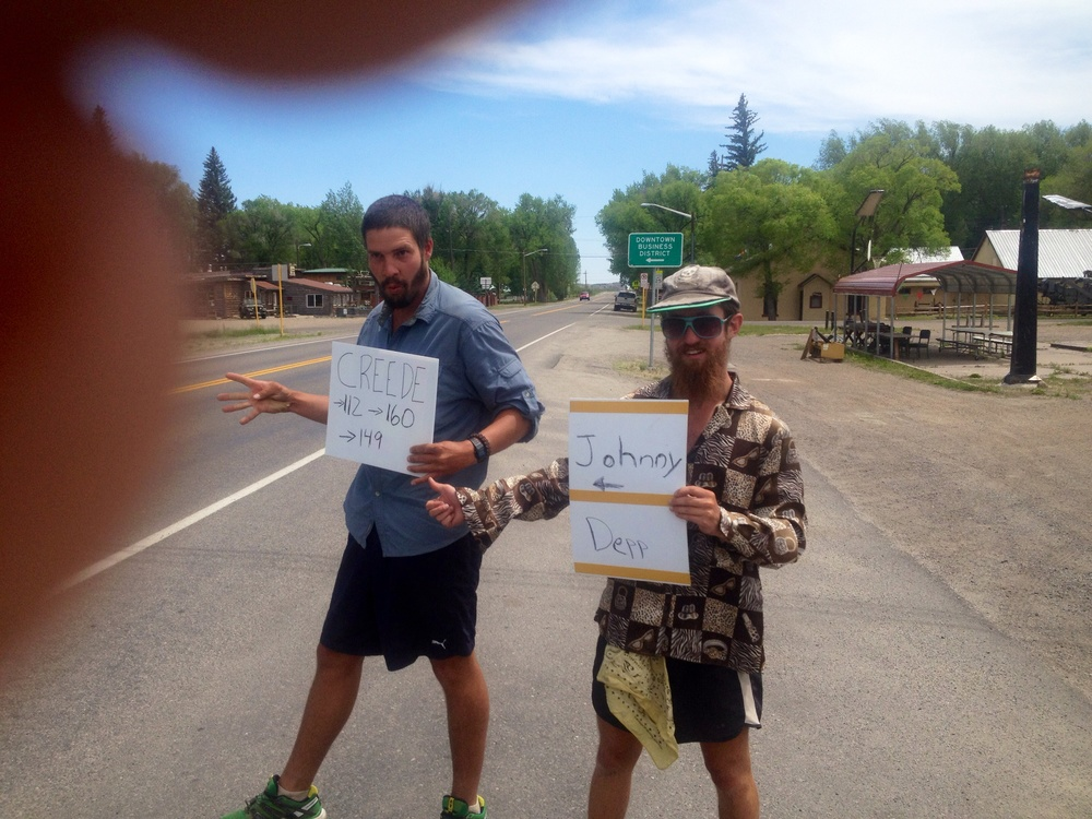 "Unconventional hitching maneuvers in Southern, CO. Signs read ""Creede"" and ""Johnny Depp <---"" It was worth a shot."
