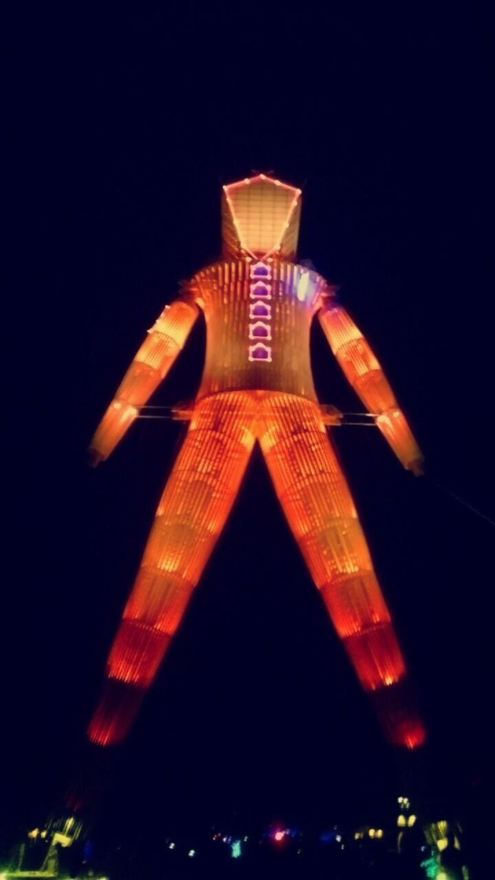 The Man illuminated at night.