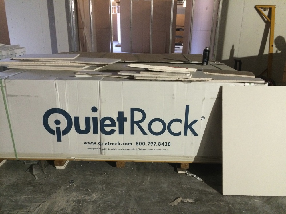 Quiet Rock is what we are using in our studio, edit suites, and theater. It will block in sound and keep sound out.
