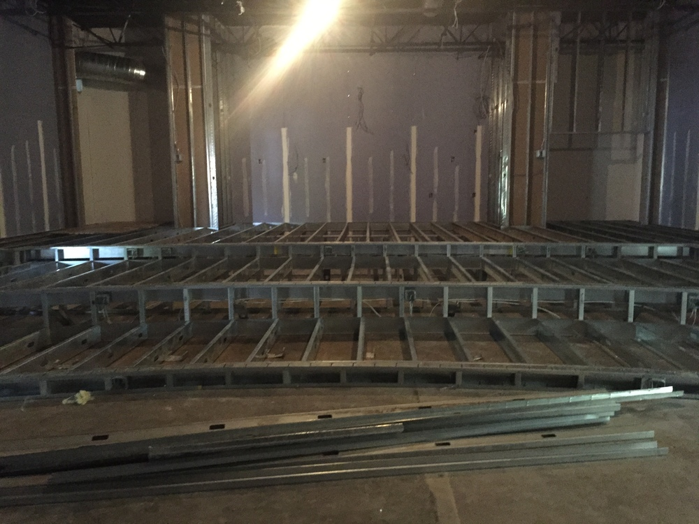 The theater is coming together. Getting the risers!