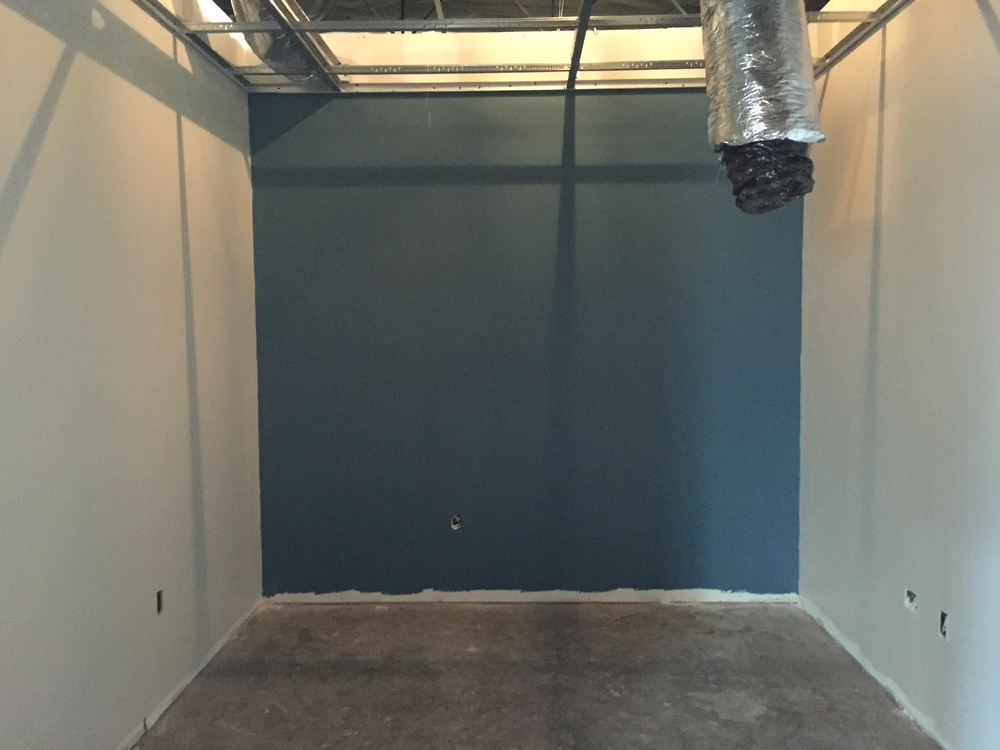 We have some offices with a back wall of blue. Forgot the paint name of this blue but it's legit.