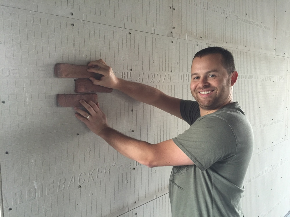 We got the brick in finally! Clint loves to demonstrate brick placement tactics.