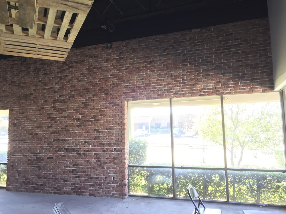 Our front area has lots of brick. This whole wall is brick... all the way through every office like...