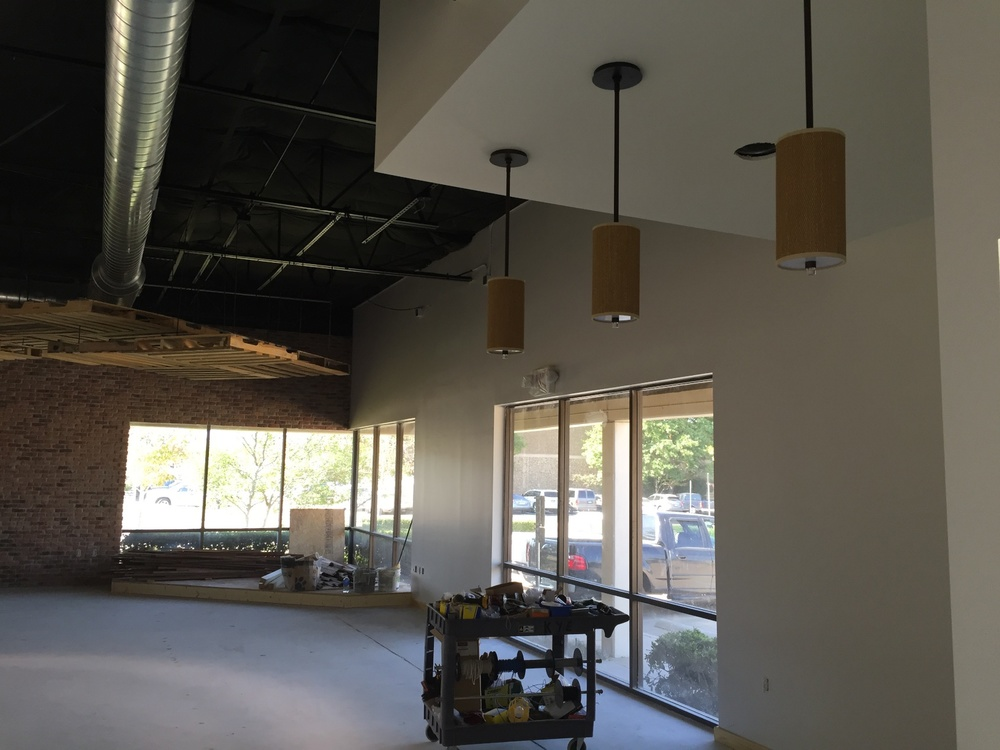 Pendant lights are hanging above the nonexistent reception desk.