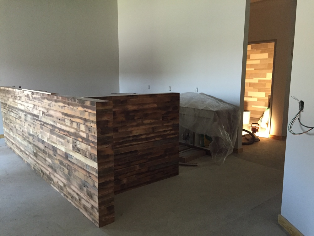The coffee bar has started. I love that wood!