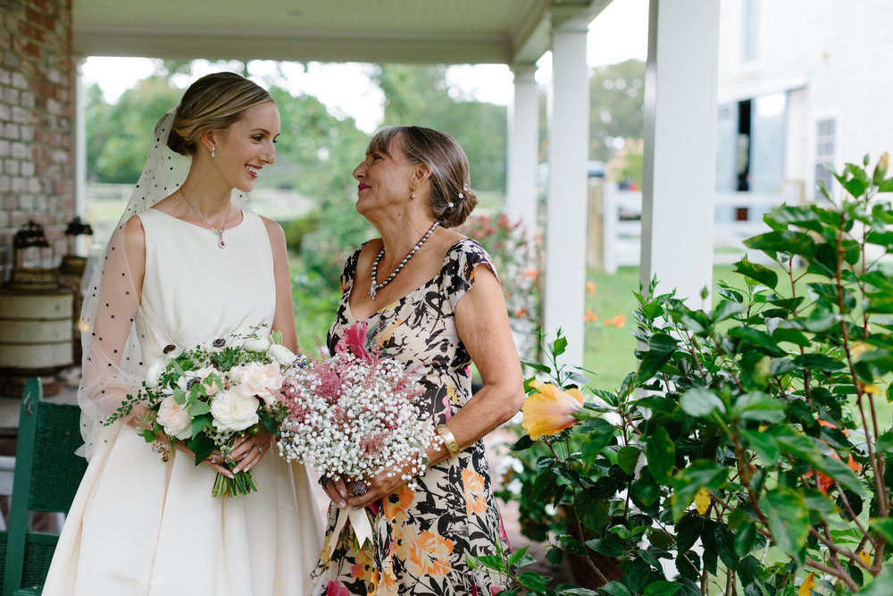 - My mother, Kai, looked so beautiful in a floral evening gown and jewelry from her company, Galatea Fine Jewelry. Our florist, Krissy Price, put together the most beautiful bouquets of Baby's Breath and Astilbe for my mom and my sister.  The bouquets looked like clouds of tiny flower buds!