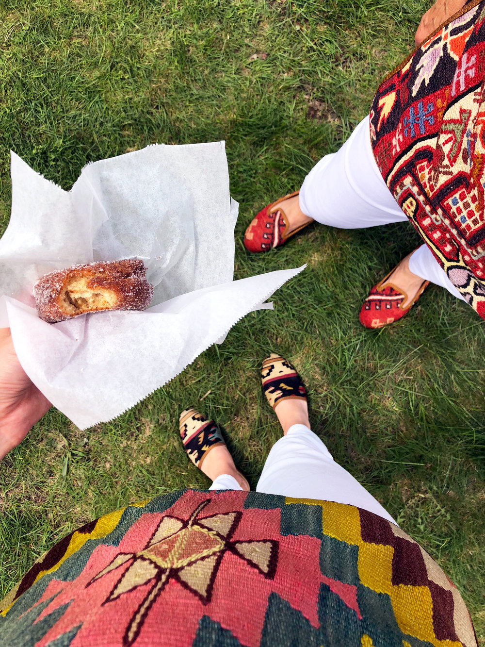 Eating donuts in Kilim Shoes.