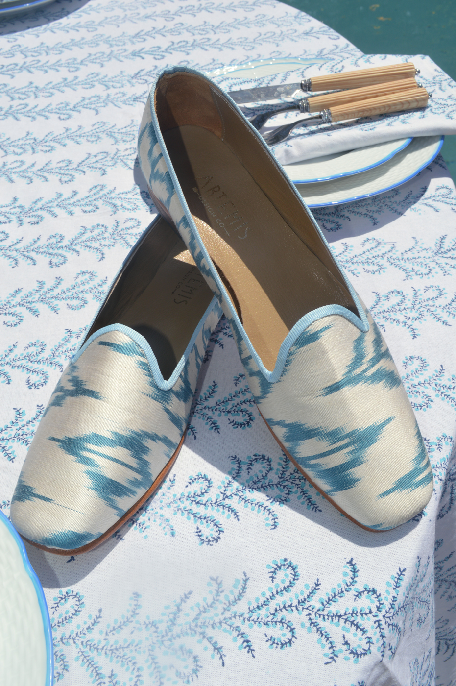 Our Jane Silk Loafers sitting on a table Julia set with her handmade linen textile.