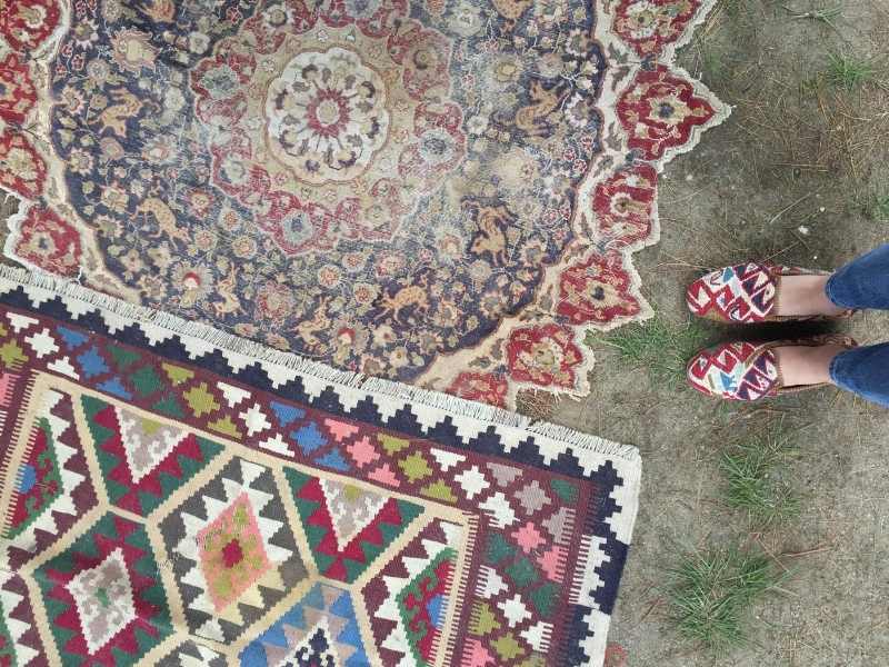 Artemis Kilim shoes on a kilim rug at brimfield market