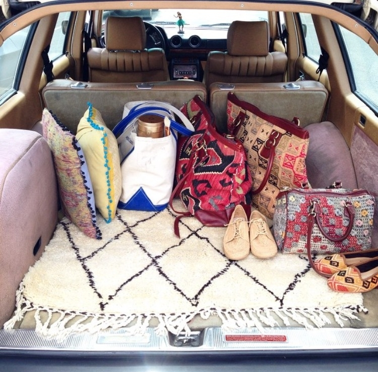 Artemis Kilim handbags and Kilim luggage in the back of an antique mercedes benz