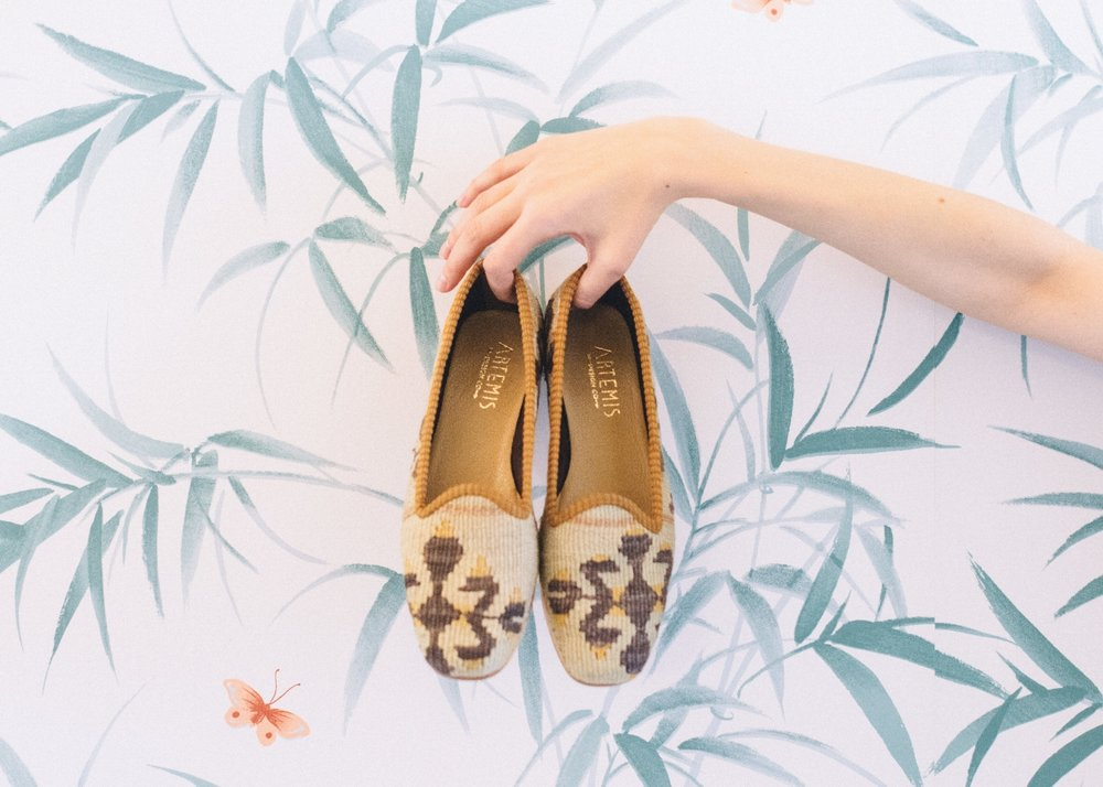 """""""Artemis is so in line with all of the things that I find interesting about design, and the things we choose to live with, and wear. Time worn, and drawing on a rich history – the shoes are all hand made using genuine Turkish carpets!""""   -Nate Berkus"""
