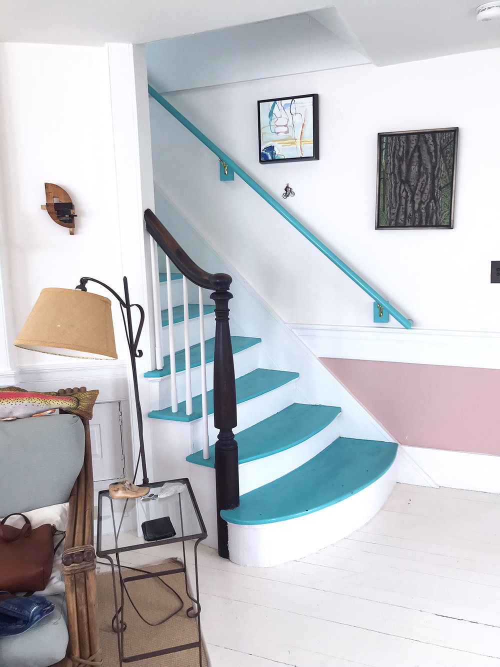 Teal stairs in a house located in Provincetown, MA.