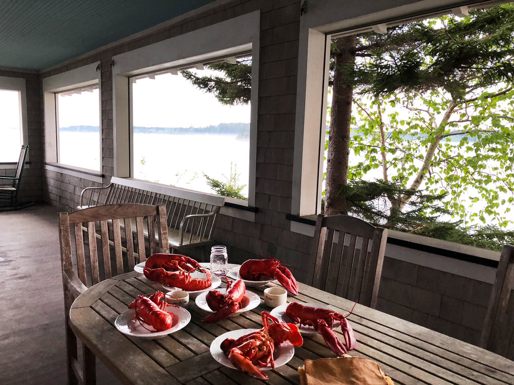 Lobsters on the table, ready to eat for dinner at Milicent's (founder of the kilim shoe) family home in Maine.