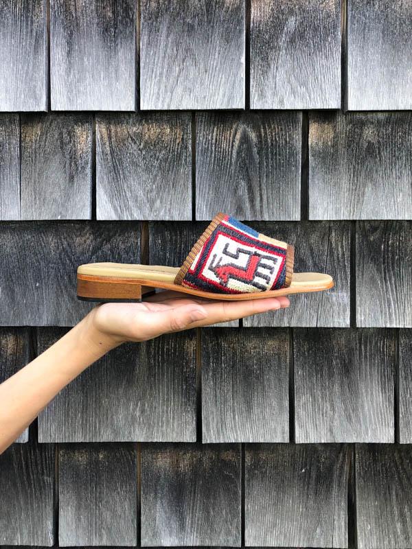 Our new Kilim Sandal against grey cedar singles.