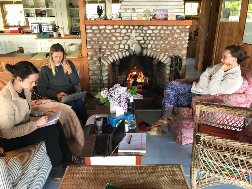 Here is our team in the middle of brainstorming session in front of the fire. We all were wearing Kilim loafers.