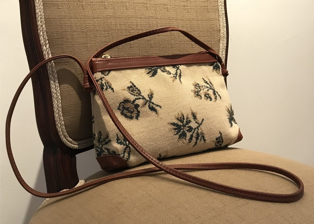 We also created this cross body bag from the textile that covered the chairs.
