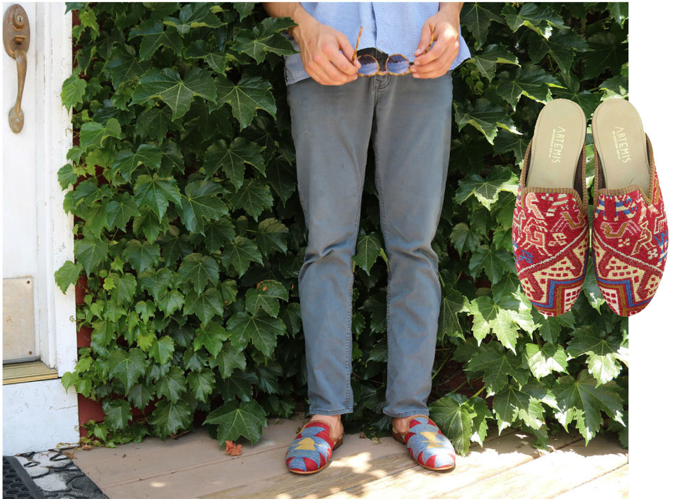 Lincoln stands in the shade, posing with a pair of sunglasses and Artemis men's kilim slippers.