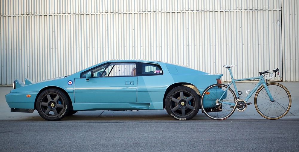 """Both these vehicles are designed to do one thing well: go very fast kinda comfortably. We restored this Esprit at our facility in Venice and this early Ace was sprayed from the leftover paint. We spent many months sanding the Lotus and prepping the surface while we were simultaneously designing the shape of the Ace, and each definitely effected the other. The shade of light blue (Pantone 2915 + 15% black) made it onto several of our models and has become the new """"official"""" Ritte blue, appearing on the production Ace, 8055, 1919 and Crossberg."""