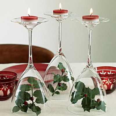 32210483075 Tip any stemmed wine glass upside. Place simple decor under the belly of  the glass such as flowers or other trinkets and then set a tealight on the  top of ...