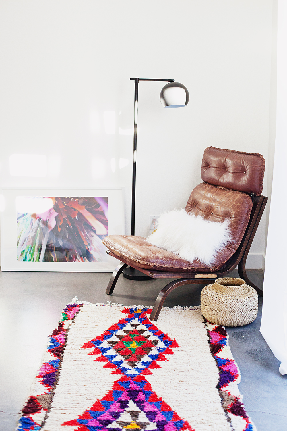 Photo print is from  Kelly Christine ; chair found on Offer Up, Rug found on Etsy, lamp is from Target, sheepskin pillow from Nordstrom Rack, basket thrifted