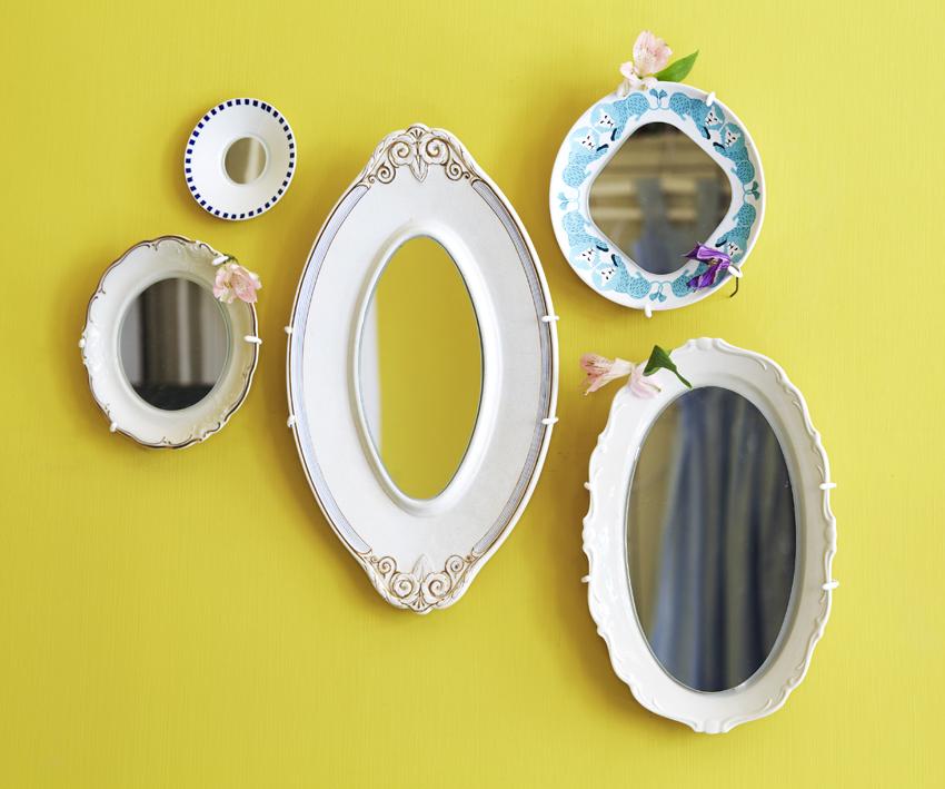 Använd tallrikar och fat som ramar till speglar.