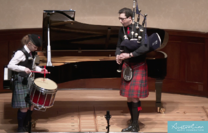 Awardee Eilidh Young playing at the 2017 AMF Finals, with piper Gavin Hardie