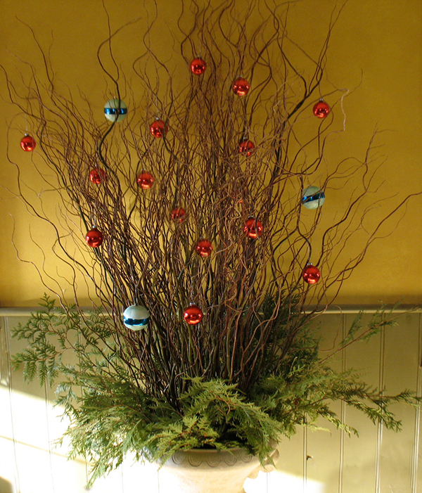 We used an urn from the garden, glass balls, green curly willow and cedar for this tree.
