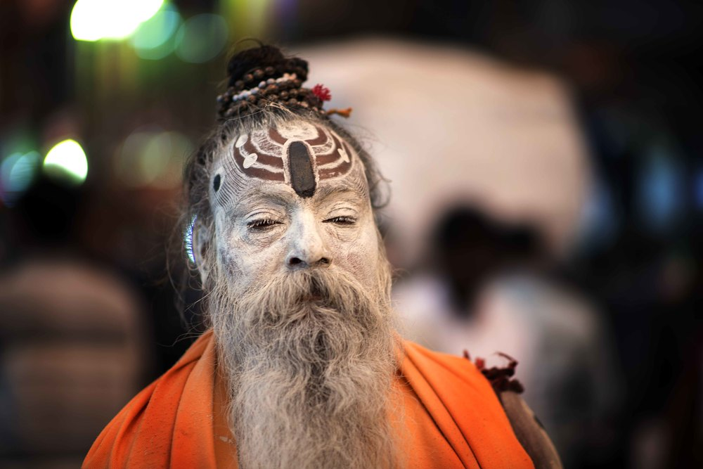 "This man is Sadhu, a ""good"" man, a holy man, dedicated to achieving liberation, the fourth and final stage of life. Sadhus, or renunciates,  have chosen to leave behind all material attachments. They live caves, forests, and temples all over India and Nepal."