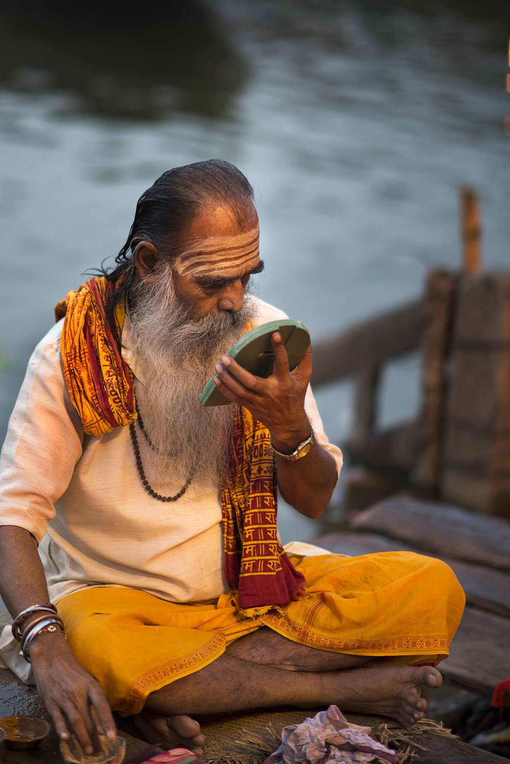 "Another Sadhu putting on his ""face""."