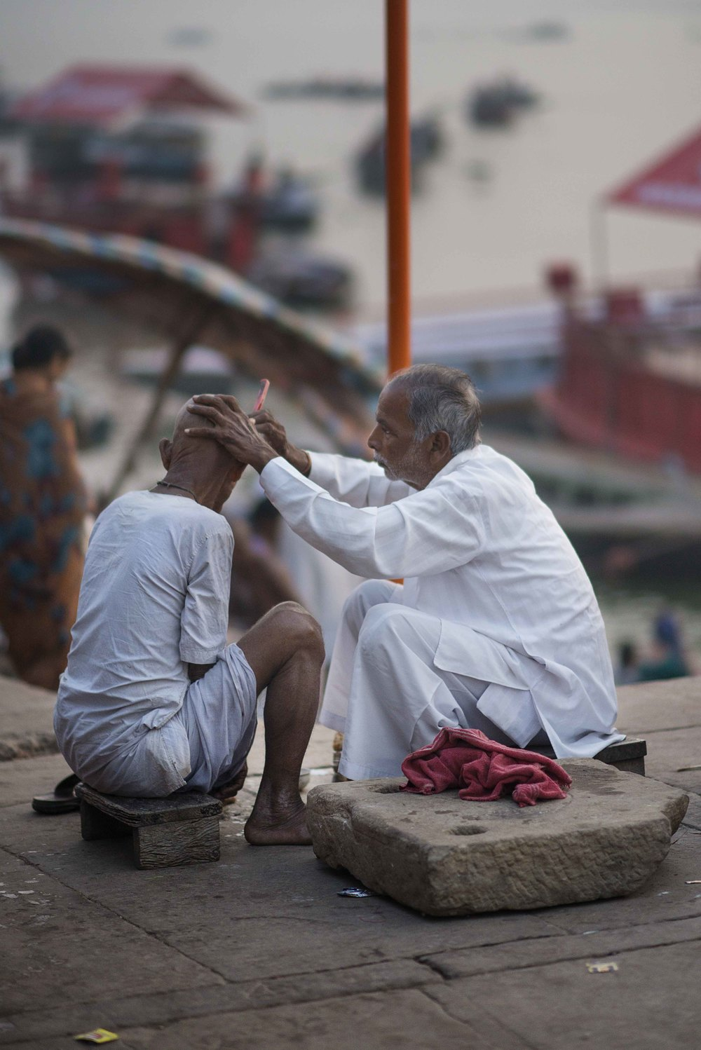 Men and women shave their heads, the men their beards as well, as a gift Mother Ganga (the river)