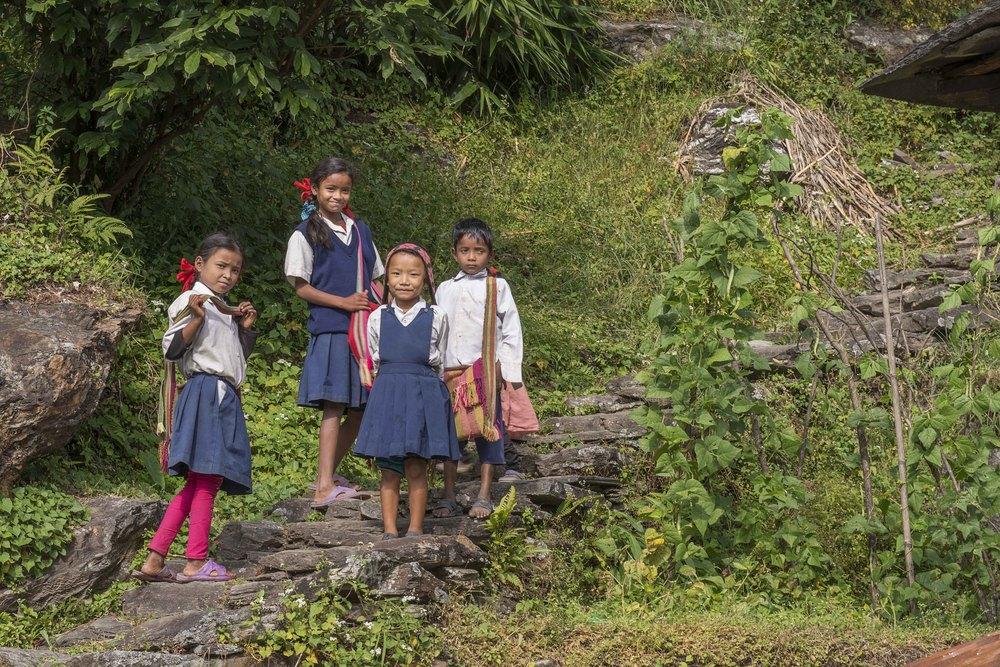 Beautiful girls on their way to school. All school children wear uniforms.