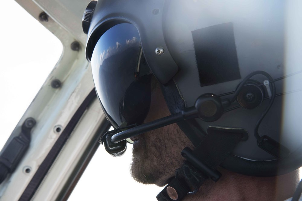 This is Major Tom, our pilot. He's the only one wearing a helmet. What does he know that we don't? Check out the reflection in his visor if you haven't seen it already.
